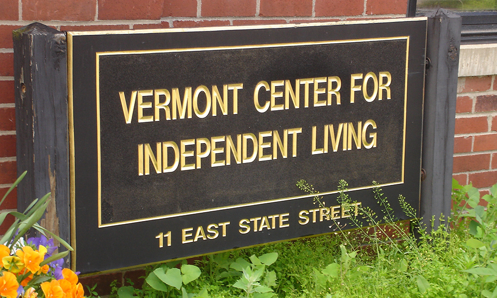 The VCIL exterior sign is large and brown with gold lettering.