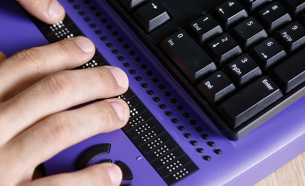 A close up of a braille keyboard.