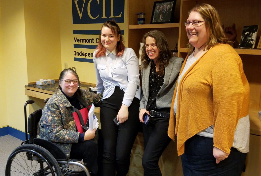 A photo of four women.  From left are Lisi-Baker; award winner Celilo Bauman-Swain; Amanda Garces (who nominated Celilo for the award) and VCIL Executive Director Sarah Launderville.